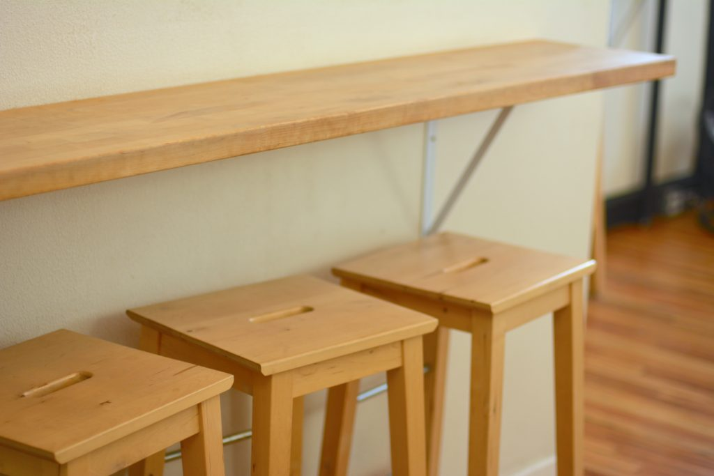 Wooden stools in a simple room